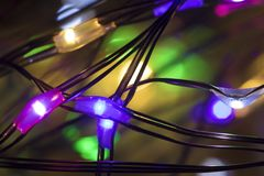 Christmas led multi-colored garland with lights inside drops very close up royalty free stock photography