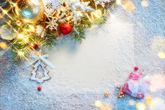 Christmas letter with decorated fir tree on snow Stock Images