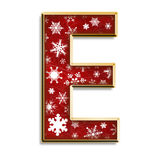 Christmas letter E in red. 3d capital E in red with white snowflakes & gold border isolated on white Royalty Free Stock Images