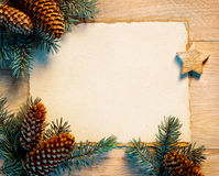 Christmas letter with fir branches, pinecones. On wooden board. Merry Christmas and Happy New Year!! Top view Stock Photography