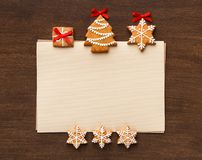 Christmas letter with gingerbread cookies, top view