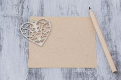 The Christmas letter with pencil. The Christmas letter wiht pencil and hart on the wooden background stock photography