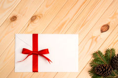 Christmas letter with red ribbon Royalty Free Stock Photos