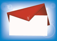 Christmas letter to Santa. Near to a red envelope. Beautiful blue background with flares Royalty Free Stock Images