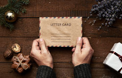 Christmas letter on wooden background Stock Photo