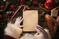 Christmas letter on wooden table Stock Photos