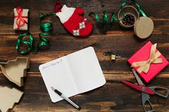 Christmas letter writing. On paper on wooden background with decorations Stock Image