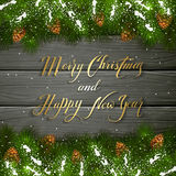 Christmas lettering on black wooden background with fir tree bra Royalty Free Stock Photo