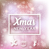 Christmas lettering design on bokeh lights background. Winter holidays card.  Stock Image