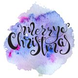 Christmas lettering hand drawn quote on colorful watercolor splash background. Print for card and prints. Royalty Free Stock Photo