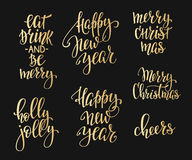 Christmas lettering typography set. Merry Christmas Happy New Year simple lettering set. Calligraphy postcard or poster graphic design lettering element. Hand Royalty Free Stock Photos