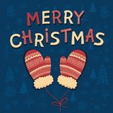 Christmas lettering with Xmas illustration. The pattern with the image of winter mittens, fir-trees, trees, bushes. Handdrawn design for greeting card Stock Photography