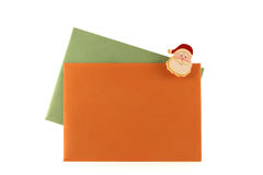 Christmas letters. In orange and green with santa Stock Photo
