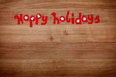 Christmas letters Happy Holidays from felt. For family holidays, Xmas or New Year, copy-space Royalty Free Stock Photos