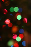 Christmas light background. Brightly colored Christmas lights on a Christmas tree Royalty Free Stock Image