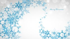 Christmas light background with blue snowflakes Royalty Free Stock Photo