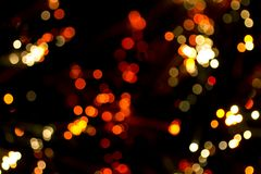Christmas light background. Background of colored lights out of focus Stock Photos