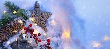 Christmas Light background. Xmas tree with snow decorated with garland star lights, holiday festive backdround stock photography
