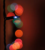 Christmas Light Blue  with other lights blurred in the red background Royalty Free Stock Photos