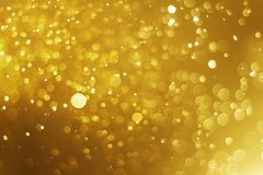 Christmas light bokeh gold color blurred background royalty free stock photography