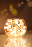 Christmas light bowl. Glass bowl filled with christmas light chain sending warm light Stock Photo
