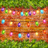 Christmas light bulbs garlands on wooden background vector Royalty Free Stock Photography