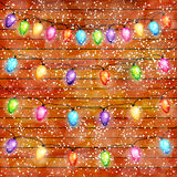 Christmas light bulbs garlands on wooden background vector Stock Photography