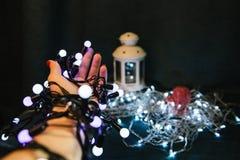 Christmas light bulbs in hands Stock Photos