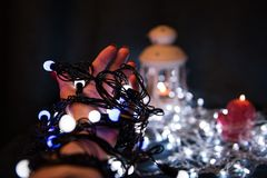 Christmas light bulbs in hands Royalty Free Stock Images