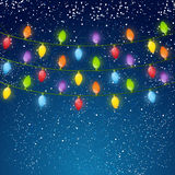 Christmas light bulbs on sky background 4 Stock Images