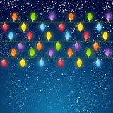 Christmas light bulbs on sky background. Christmas light bulbs on dark sky background Royalty Free Stock Photo