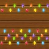 Christmas light bulbs on wood Stock Photo
