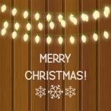 Christmas light bulbs on wood Royalty Free Stock Image