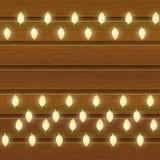 Christmas light bulbs on wood Stock Image