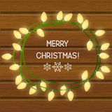 Christmas light bulbs on wooden background Royalty Free Stock Photos