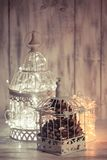 Christmas light in a cage. Christmas light decoration in a white bird cage Royalty Free Stock Photos