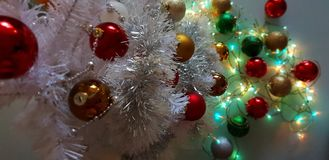 Colorful Christmas light,White Balls decoration ,illumination ideas,Christmas tree with colorful decoration stock photography