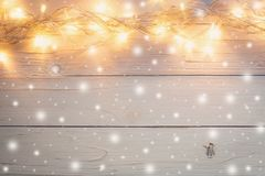 Christmas light and christmas decoration with snow on white wood stock photo