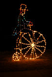 Christmas Light Display. Christmas lighting shaped like an old fashion man & large wheel bike, in local park Royalty Free Stock Photos