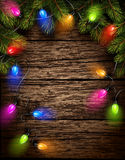 Christmas light with fir branches. On old wooden texture. Vector illustration Royalty Free Stock Photography