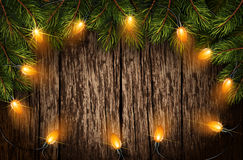 Christmas light with fir branches. On old wooden texture. Vector illustration Royalty Free Stock Image