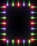 Christmas Light Frame on black. A frame made of small Christmas lights with a blank center Stock Photos