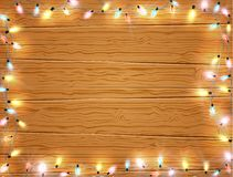 Christmas light frame, christmas banner on wooden background Royalty Free Stock Photography