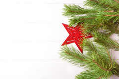 Christmas light frame decorated with red star and fir branches . Copy space on the edge Royalty Free Stock Photography