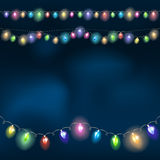 Christmas light garland on the night sky. Vector illustration Stock Photos