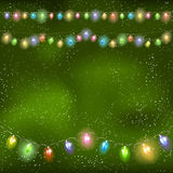 Christmas light garland on the night sky. Stock Photo
