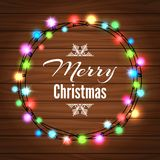 Christmas light garland on wood background. Christmas colorful light garland on the wood background, vector illustration Royalty Free Stock Photography