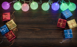 Christmas light and gift ornaments on old wood background. Christmas light and gift ornaments on old wood background Stock Image