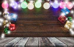 Christmas light and gift ornaments and perspective old wood. Stock Image