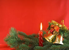 Christmas light and golden bells Stock Photos